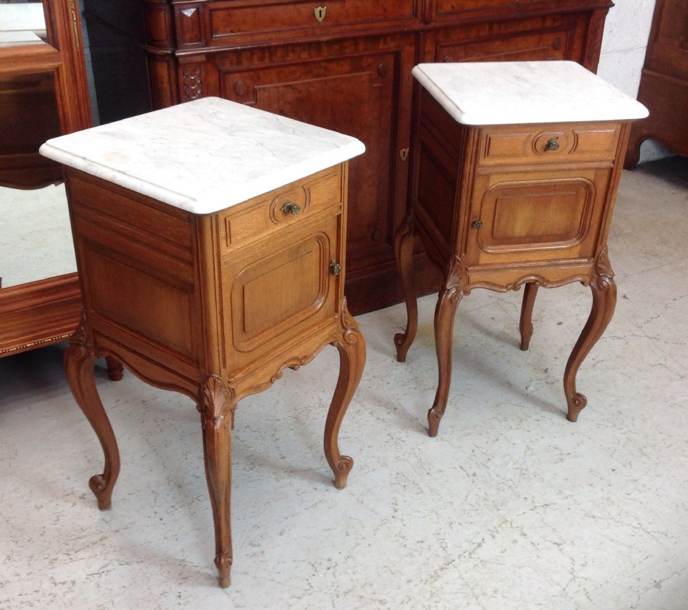 pair of light oak french bedside cabinets