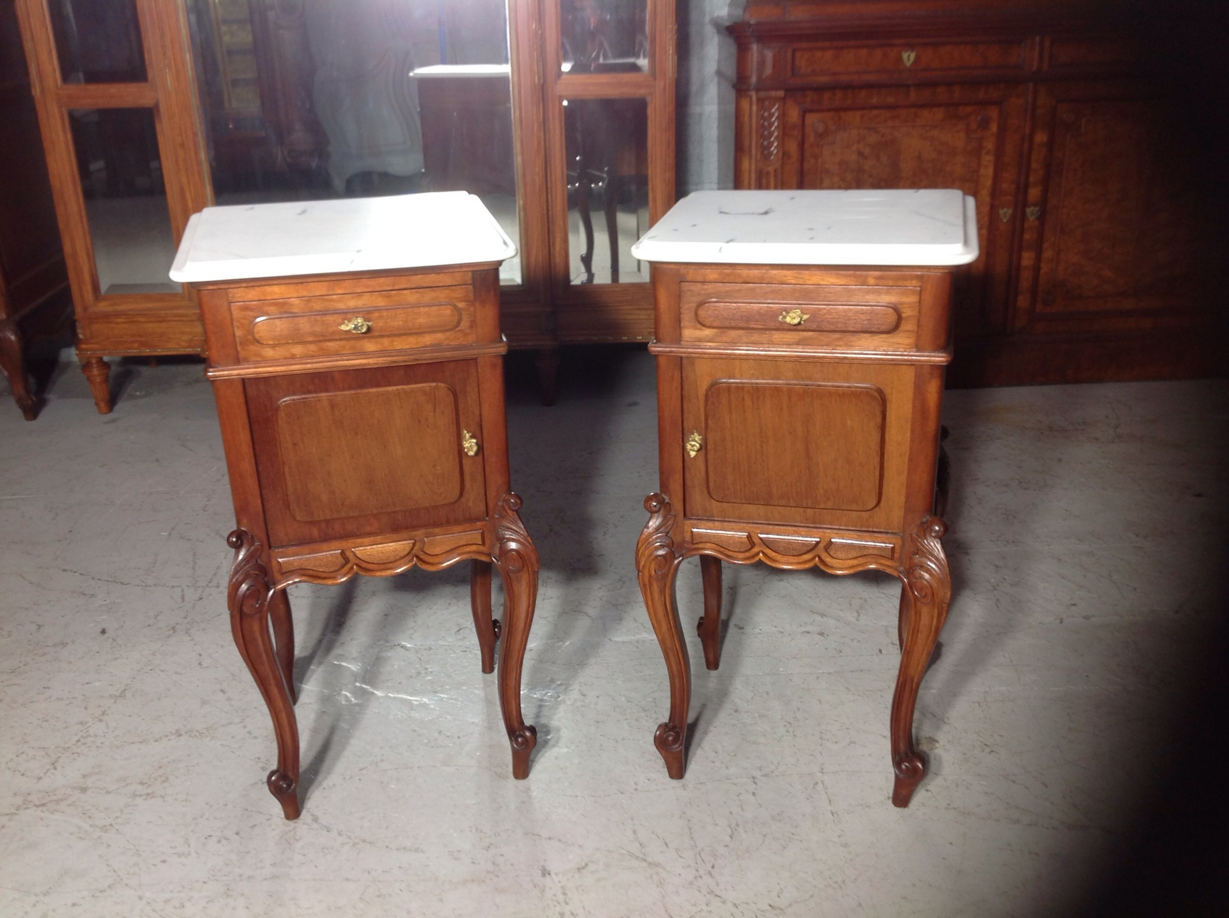 pair of french mahogany bedside cabinets