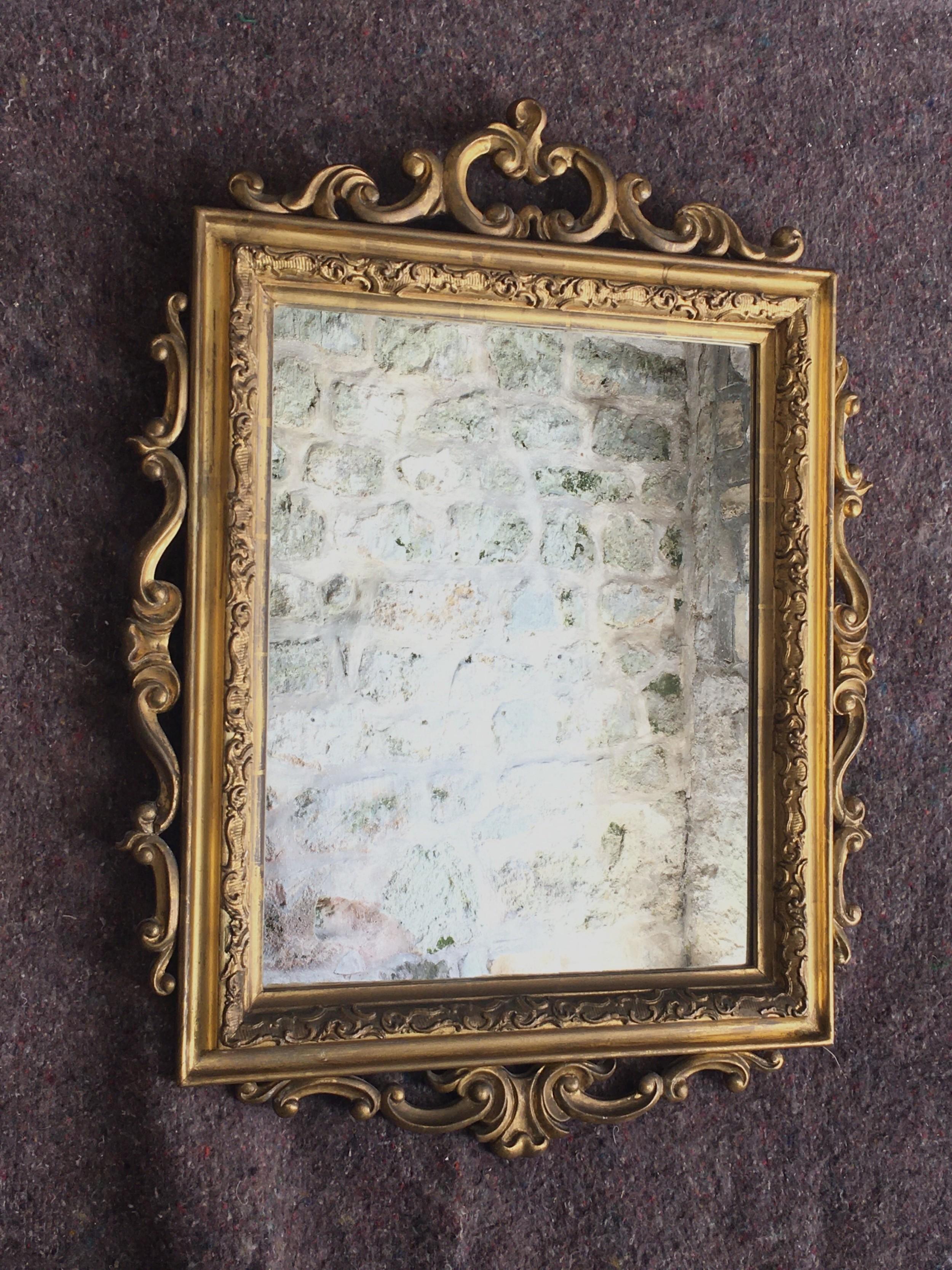 attractive gilt framed wall mirror