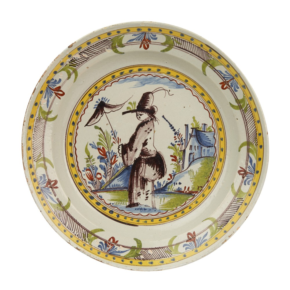 rare dutch delft polychrome dish with lady figure c1730