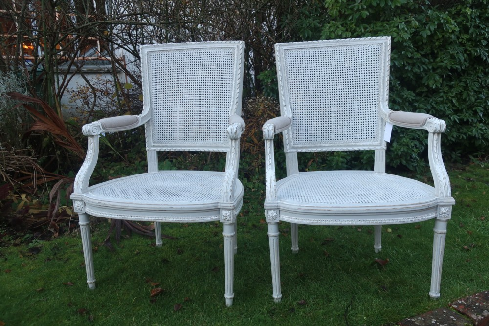 pair of painted cane armchairs
