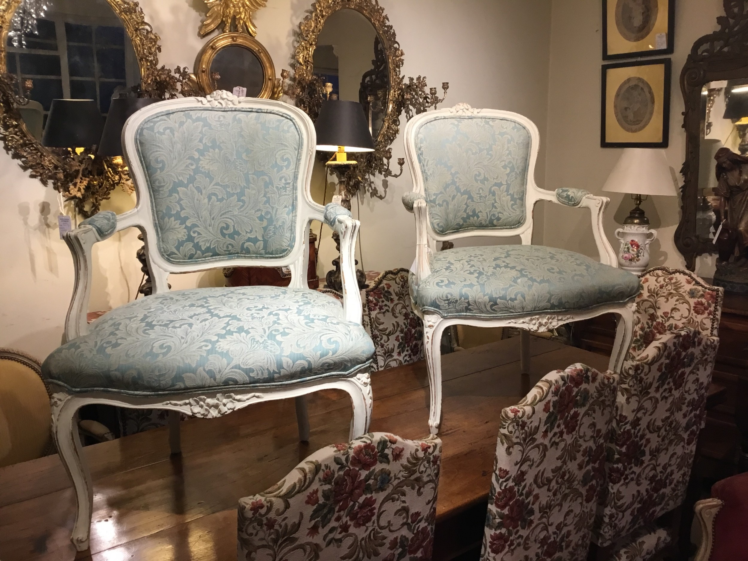 a pair of pretty french open armchairs