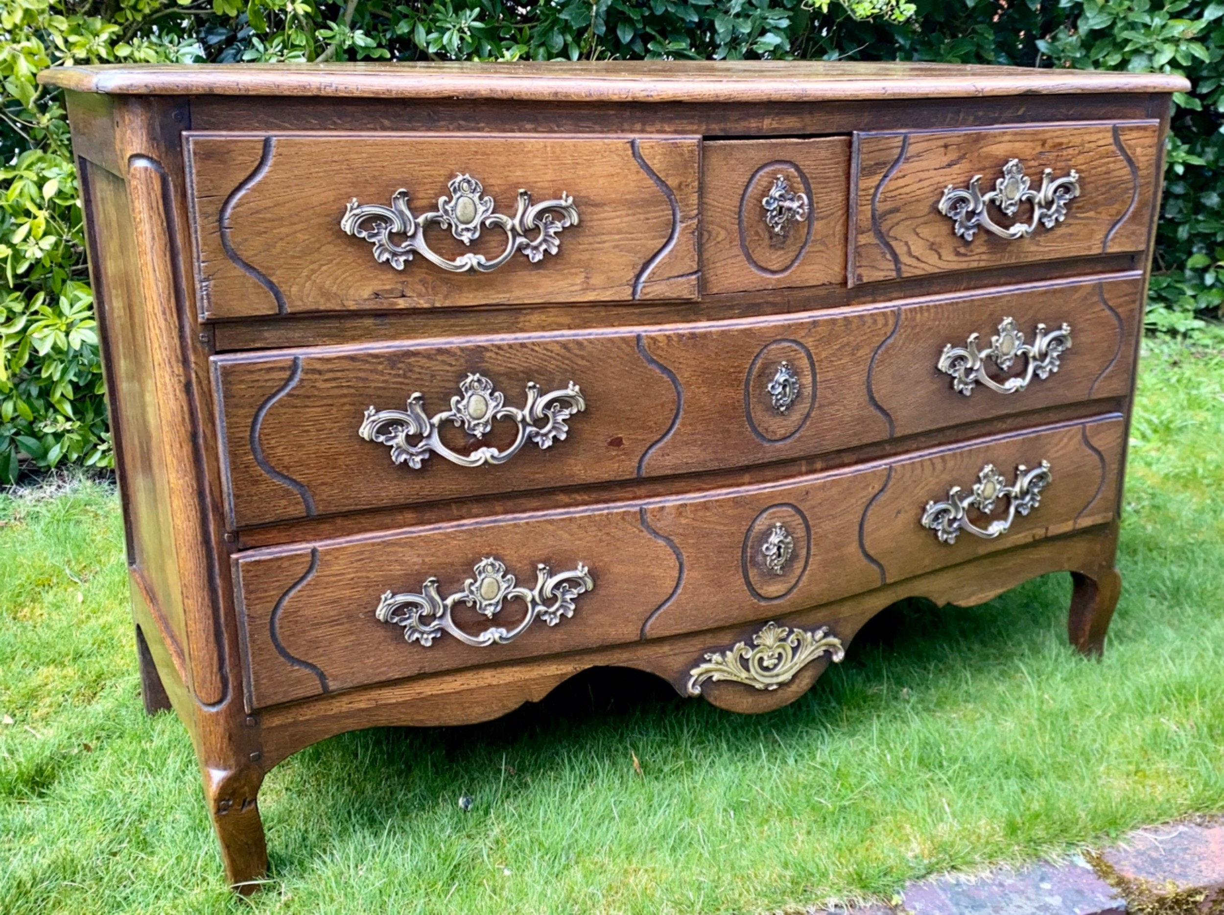 louis xv serpentine fronted commode in oak