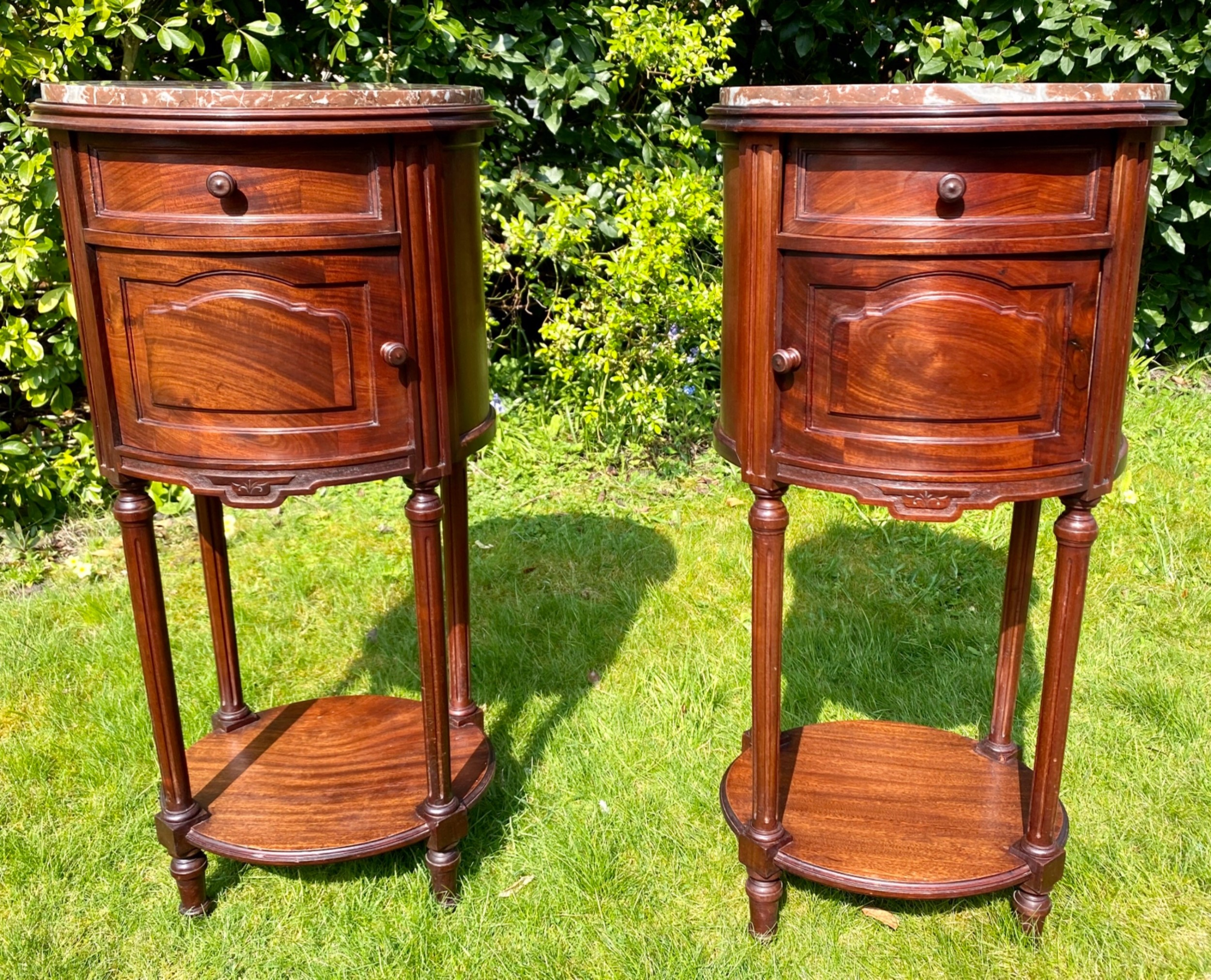 pair of french mahogany bedside tables