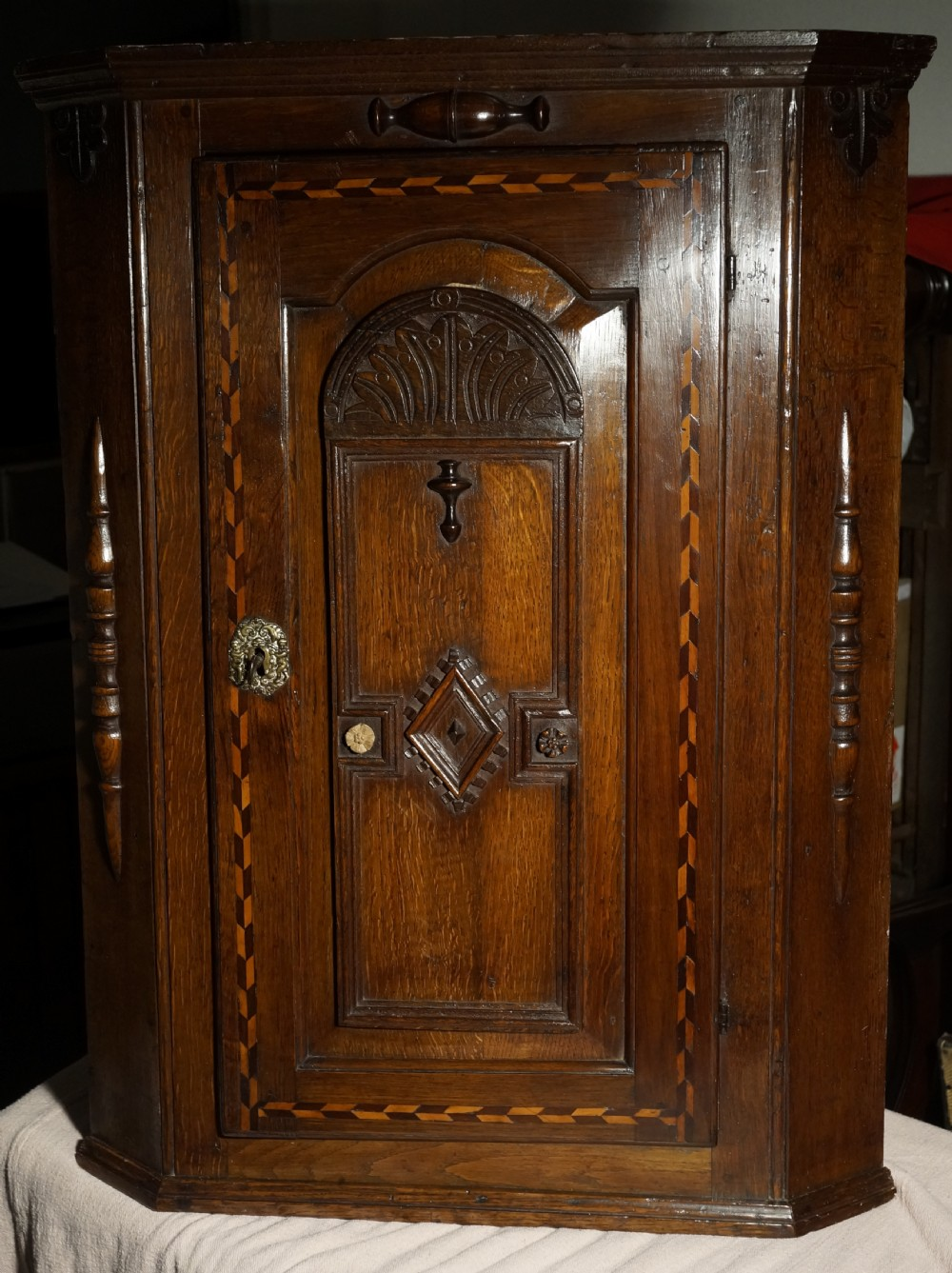 oak inlaid corner cupboard with unsual door and inner decoration circa 1720s