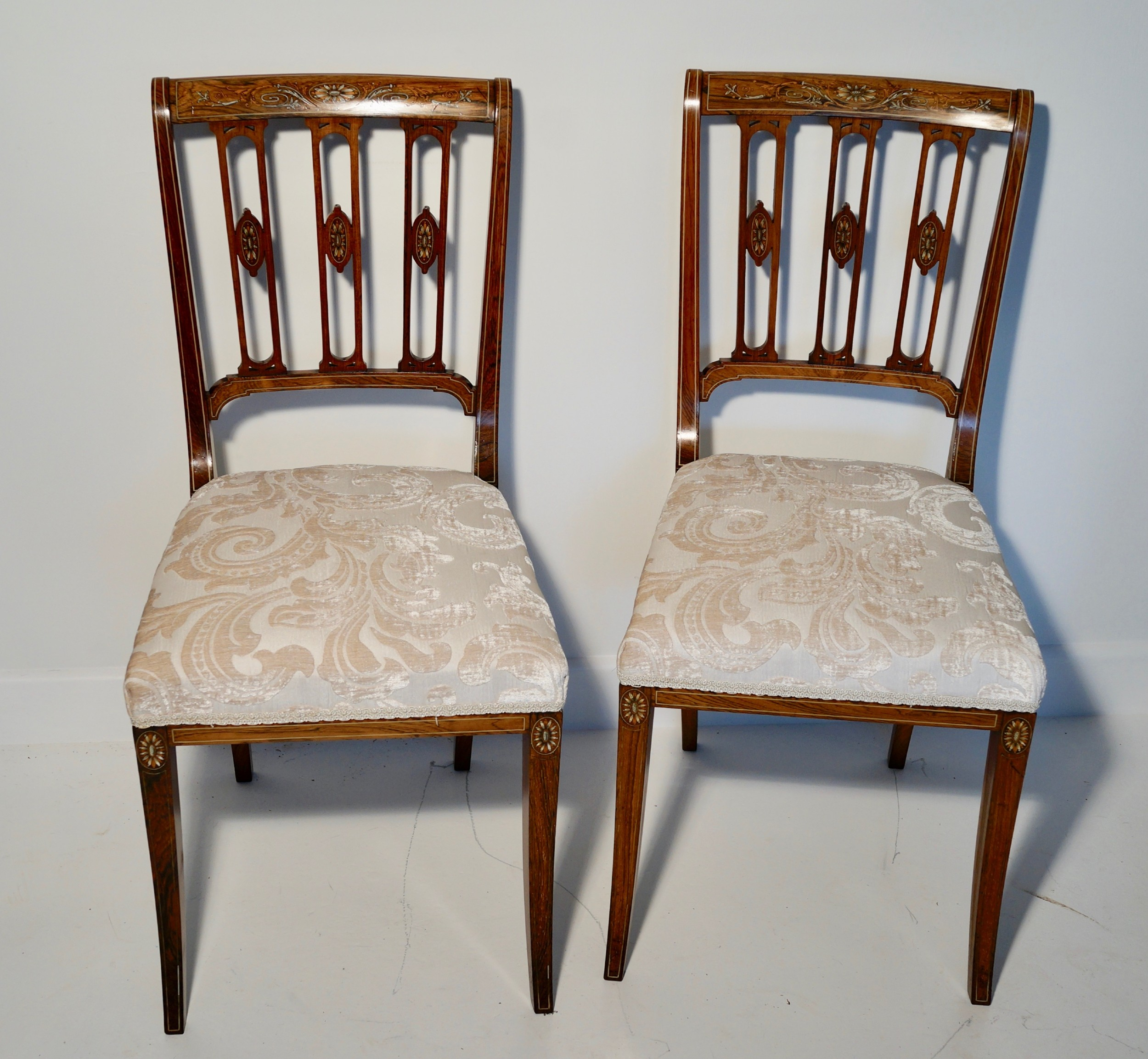 a superb edwardian pair of solid inlaid rosewood chairs