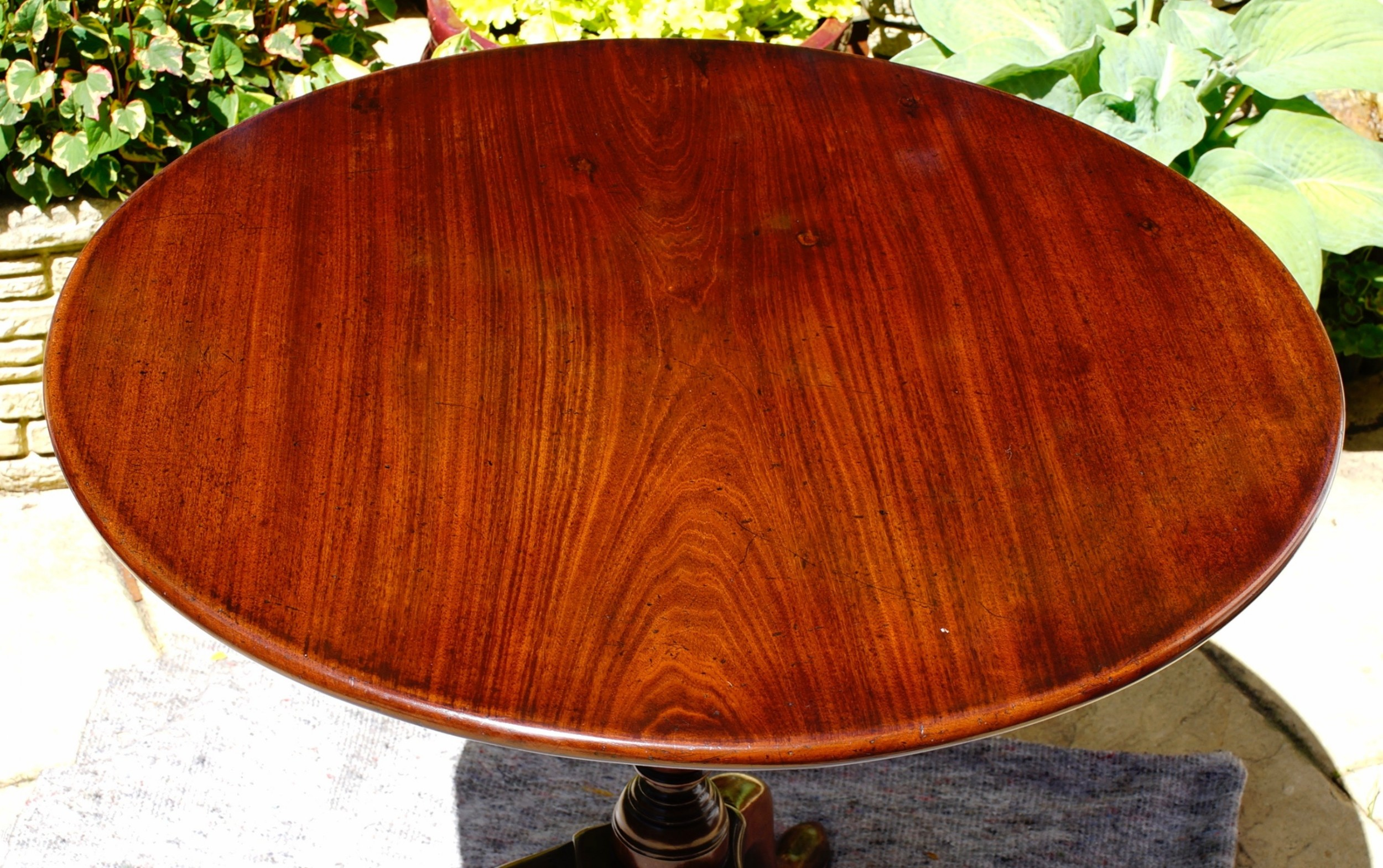 george 11 mahogany tripod table with onepiece top in well used solid condition