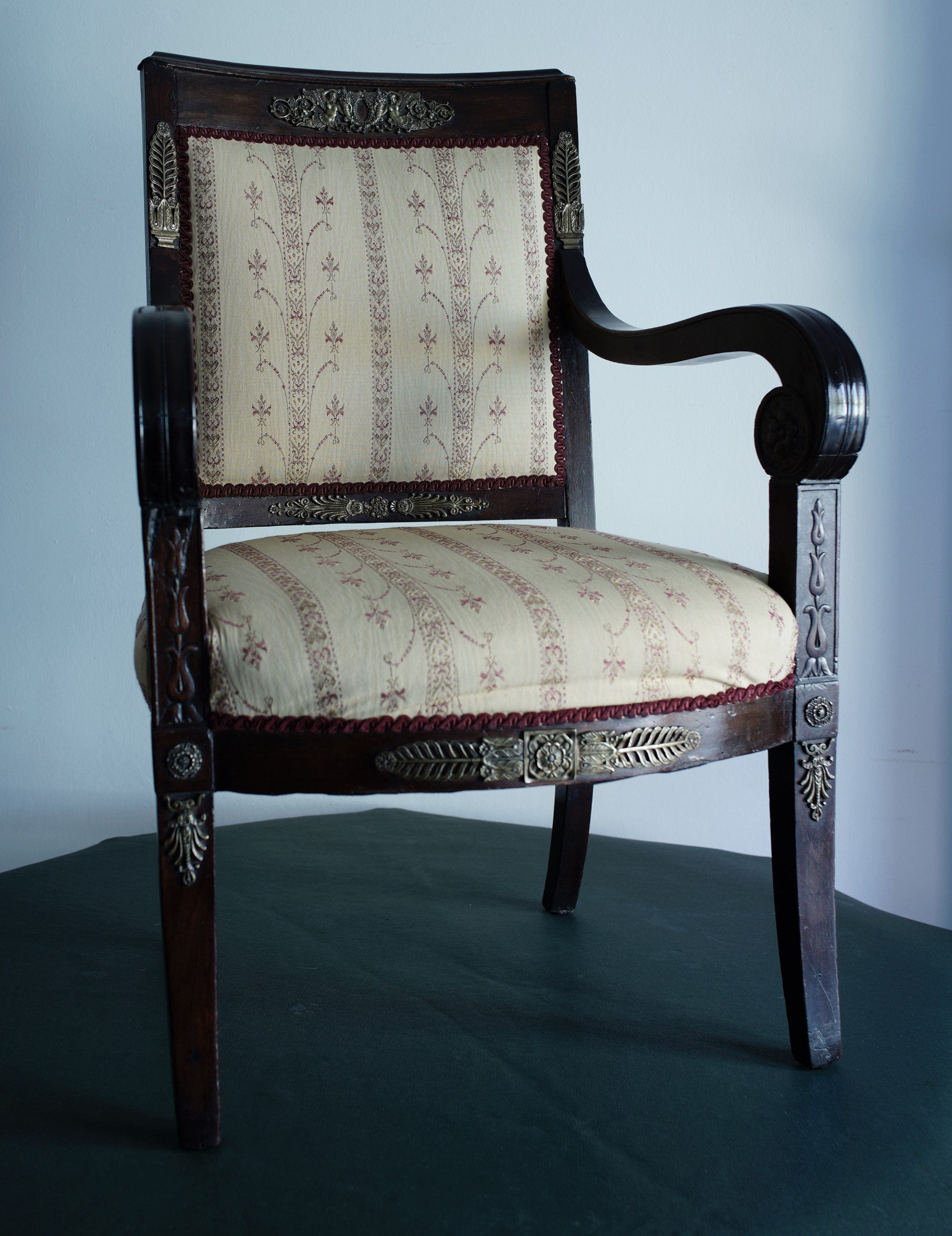 mahogany napoleonic and heavily mounted brass upholstered armchair