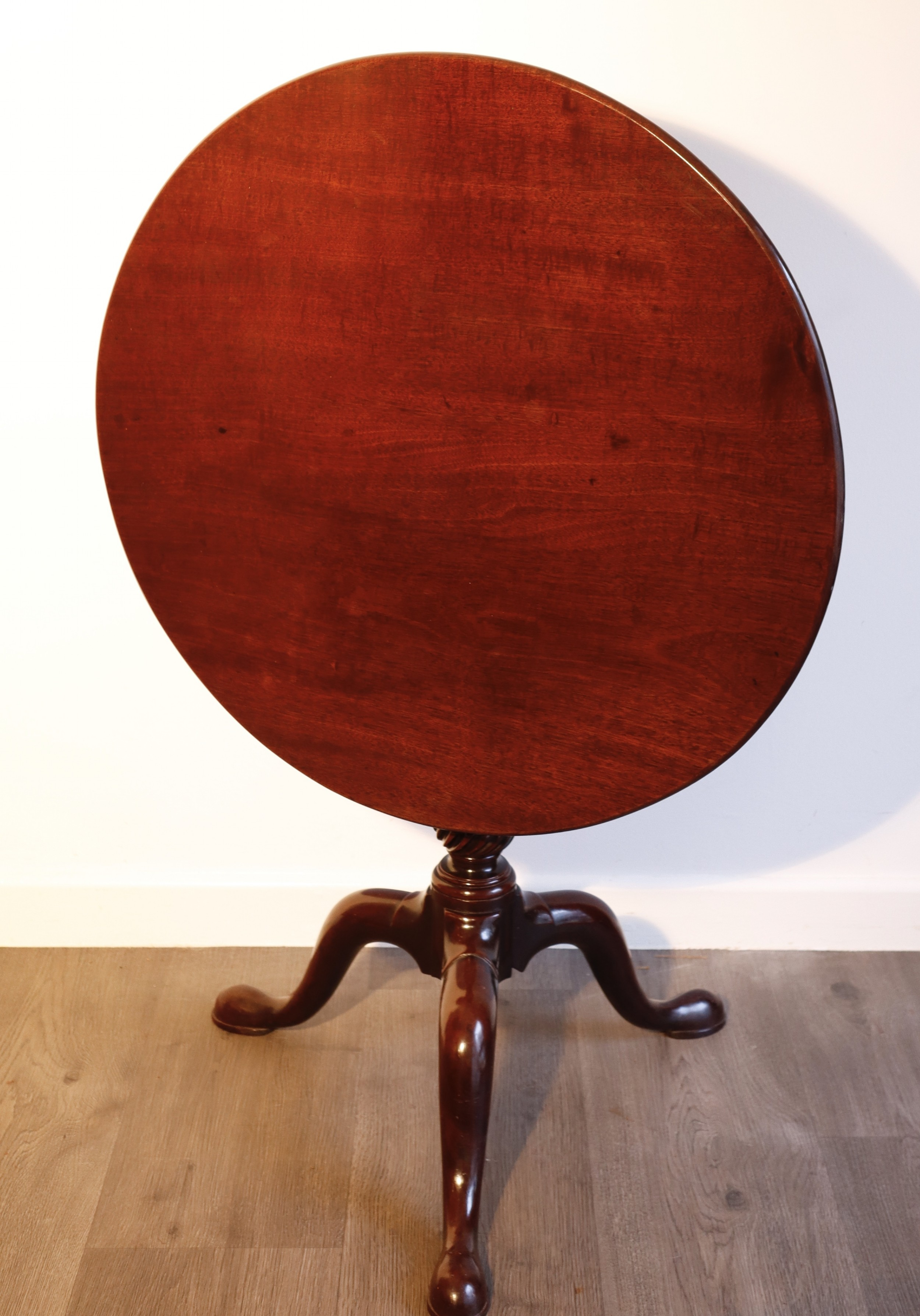 mahogany birdcage revolving table supported on finely carved and turned tripod base