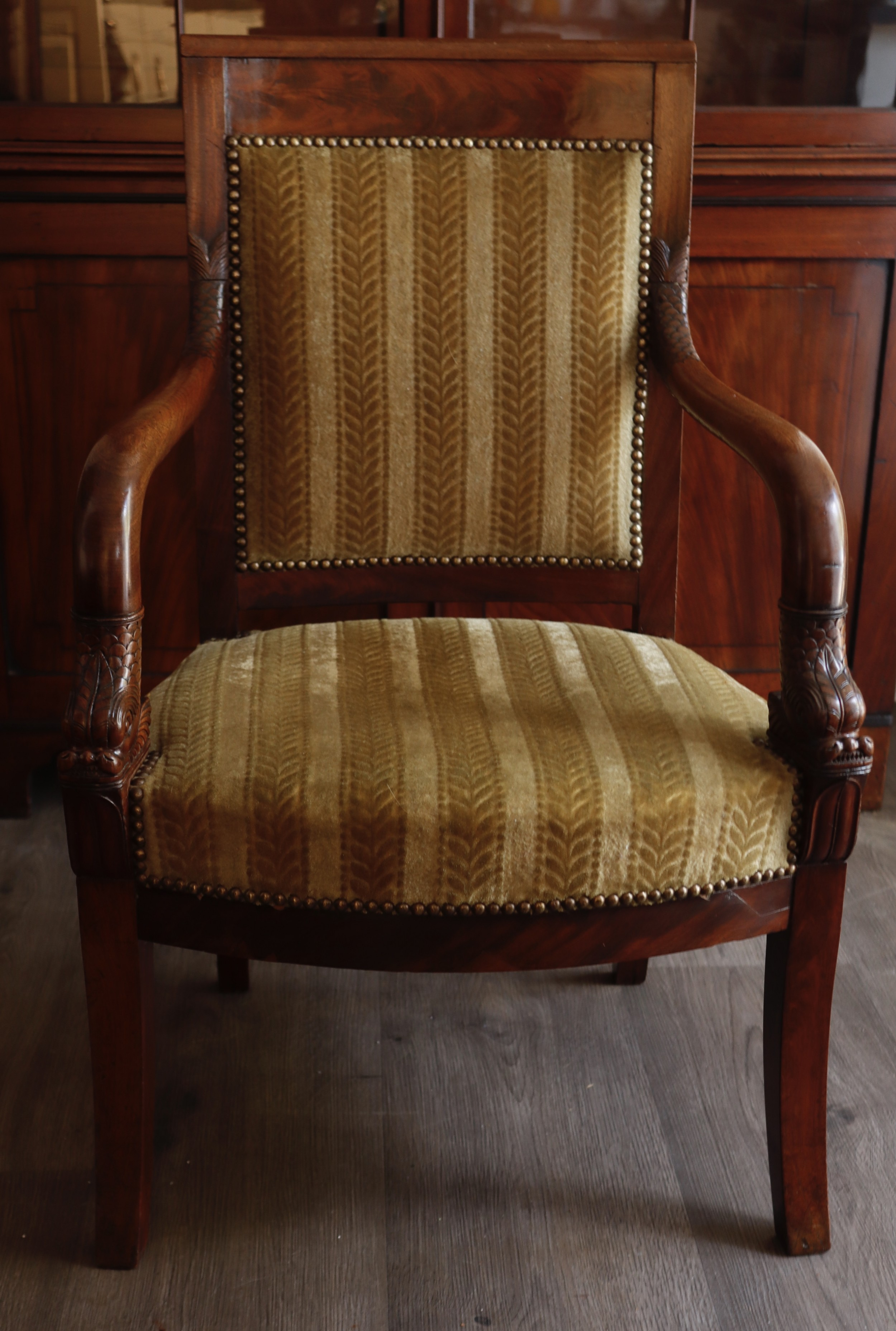 mahogany arm chair with finely carved decoration