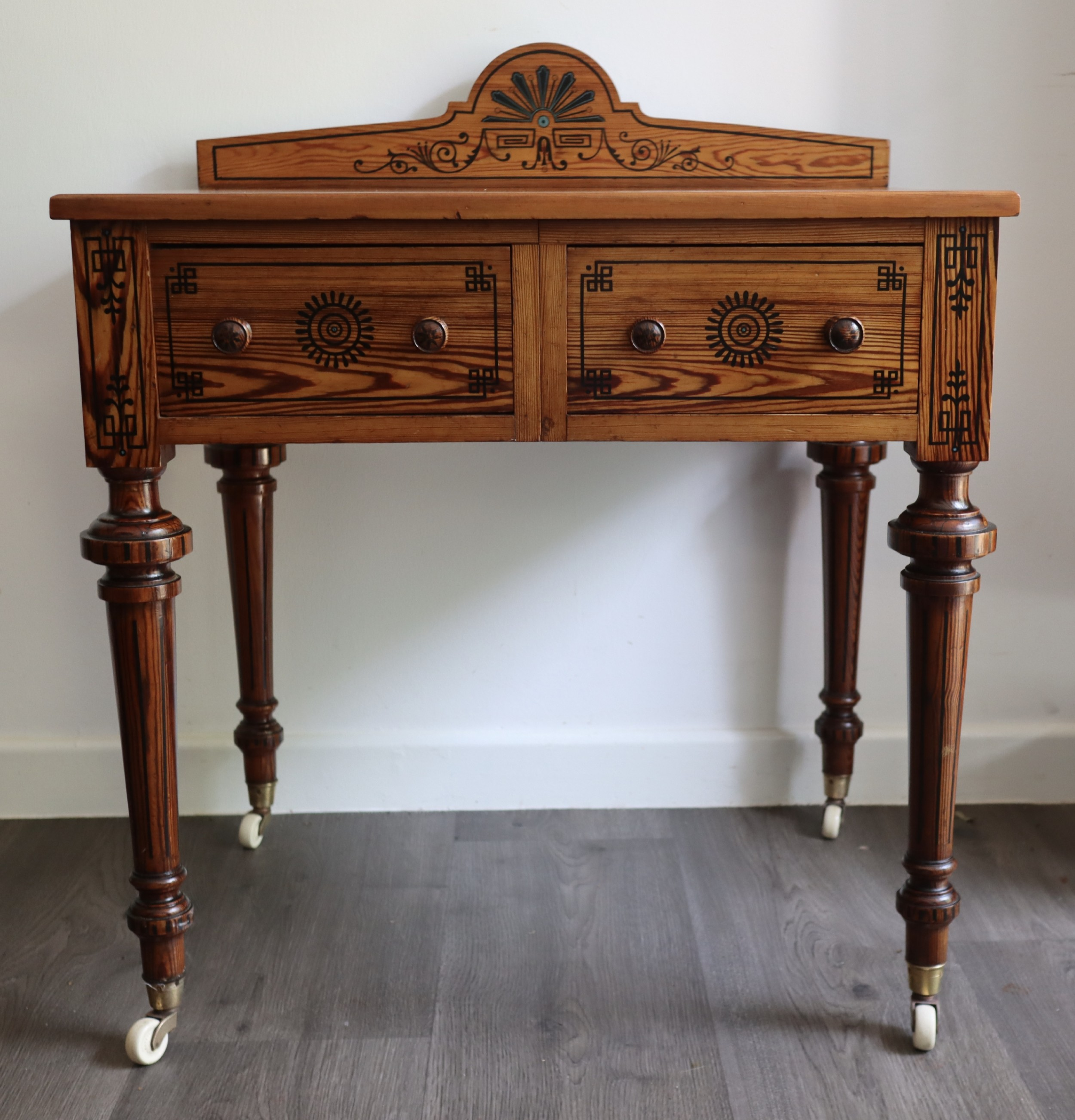 pitch pine highly decorated side table circa 1875