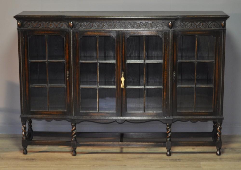 attractive large oak four door bookcase cabinet on barley twist legs