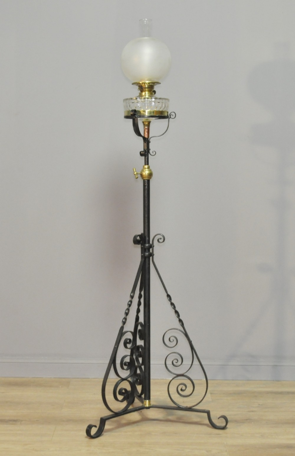 attractive tall vintage glass paraffin lamp on wrought iron extending base