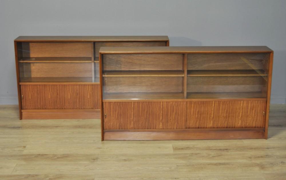 pair of retro herbert gibbs long low teak glass sliding door bookcase cabinets