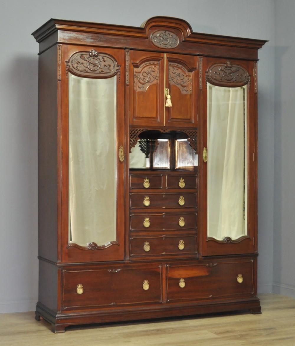 large antique victorian carved mahogany mirror door triple combination wardrobe