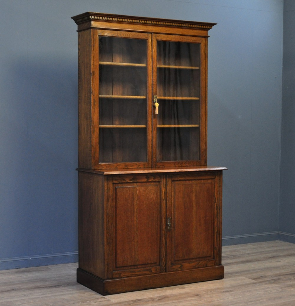attractive large tall antique victorian oak glazed door bookcase cabinet