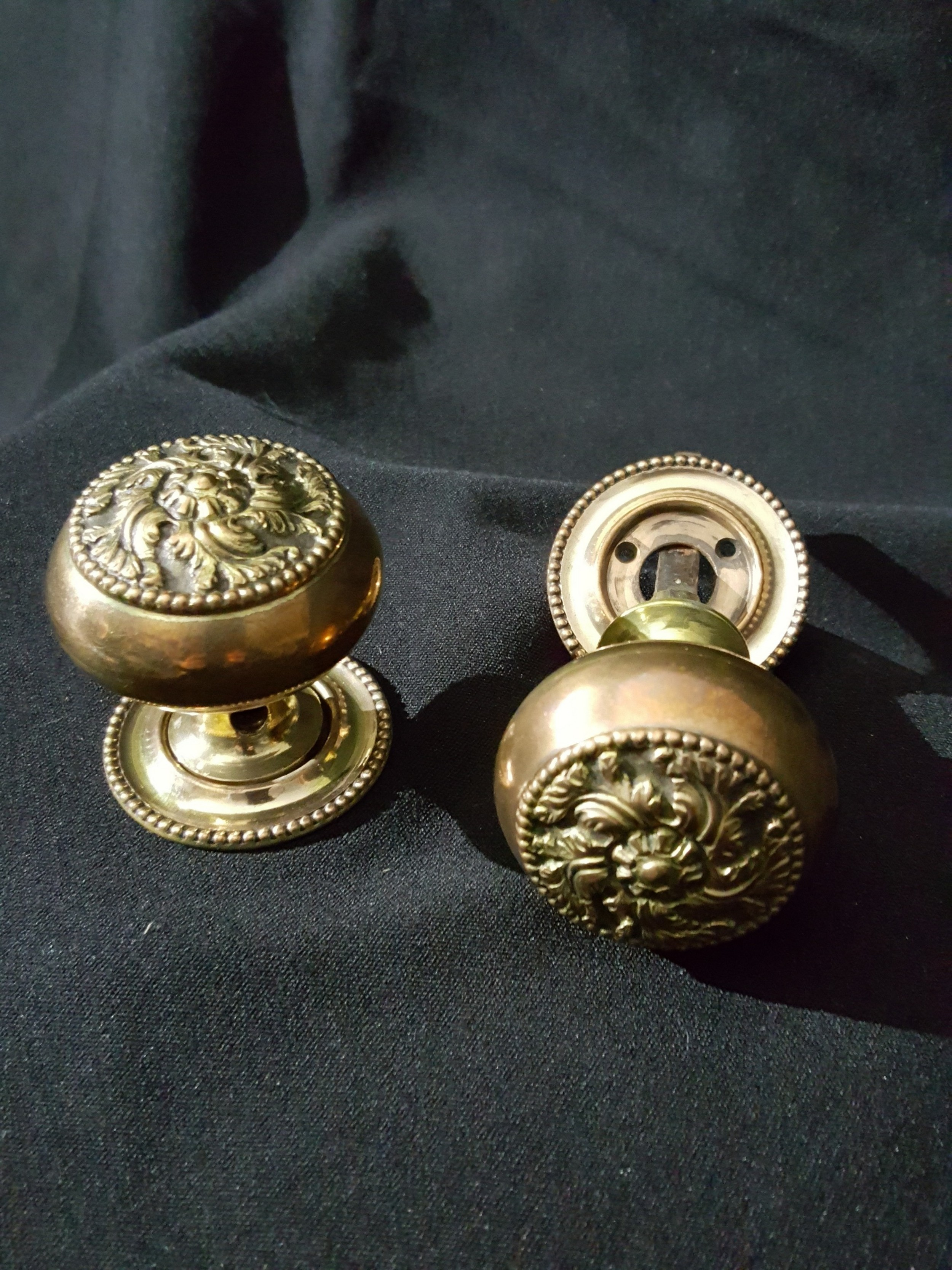 pair of bronze brass regency door knobs