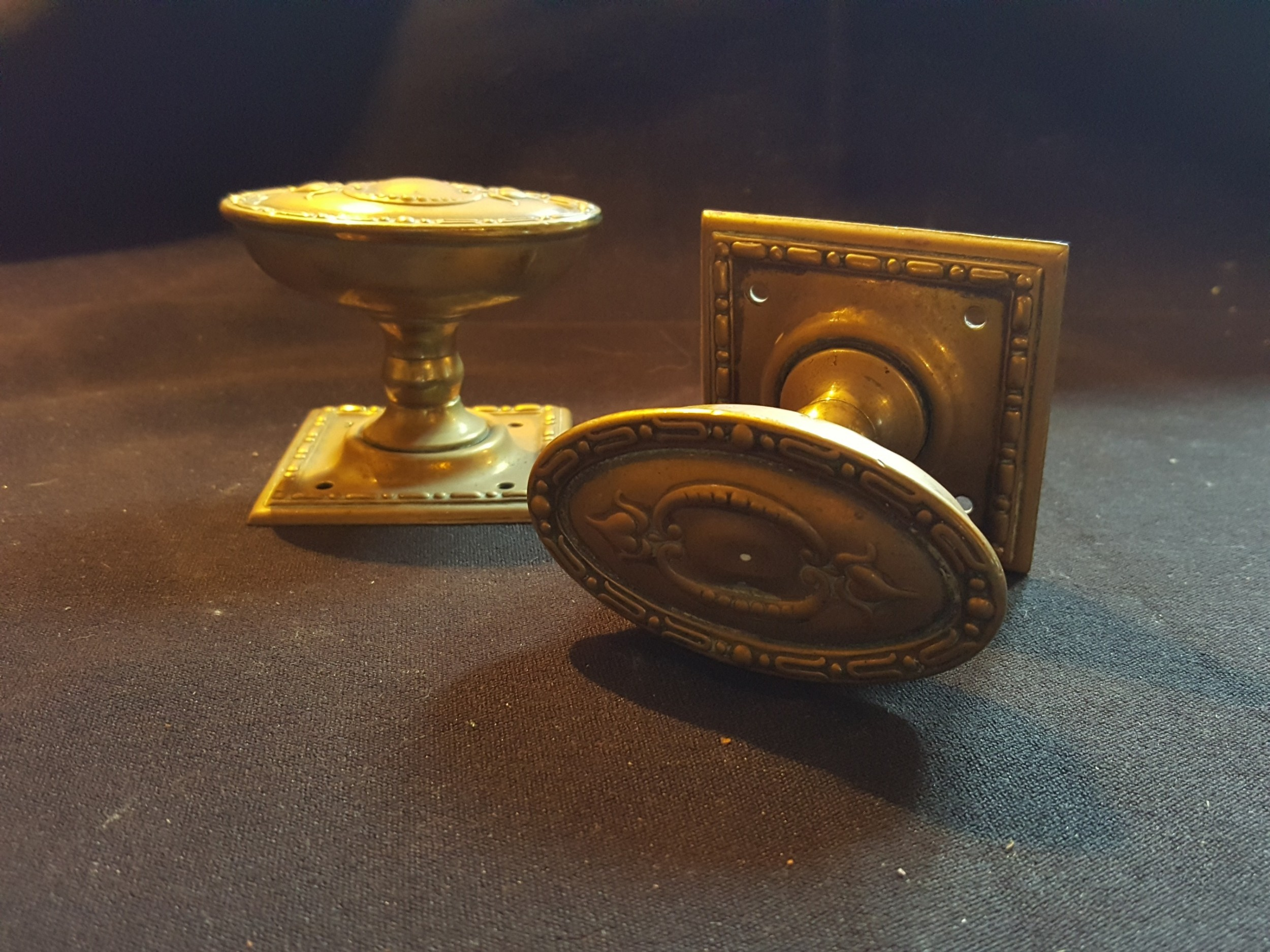 one pair of regency brass door knobs