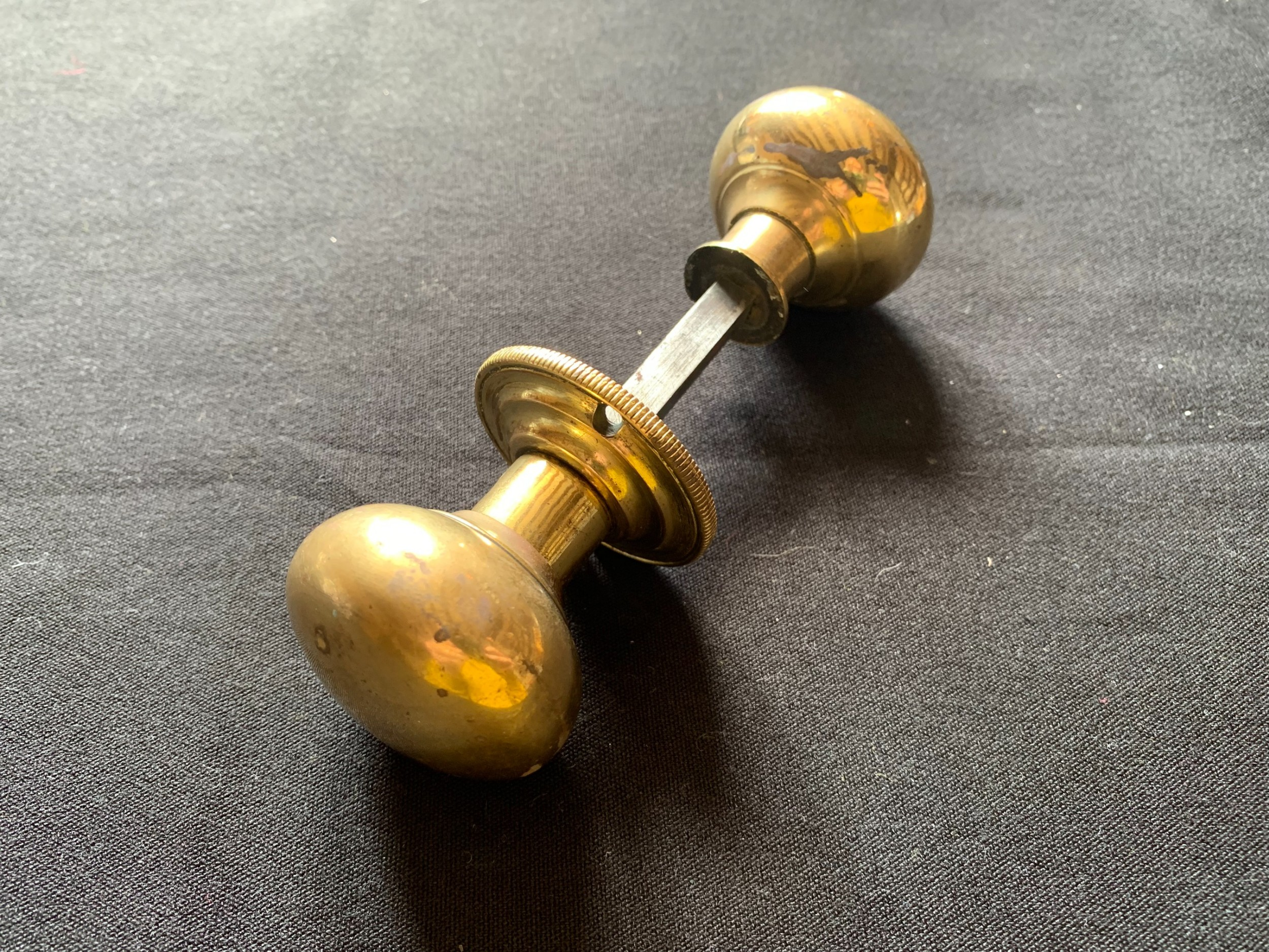 one pair of brass georgian rim lock door knobs