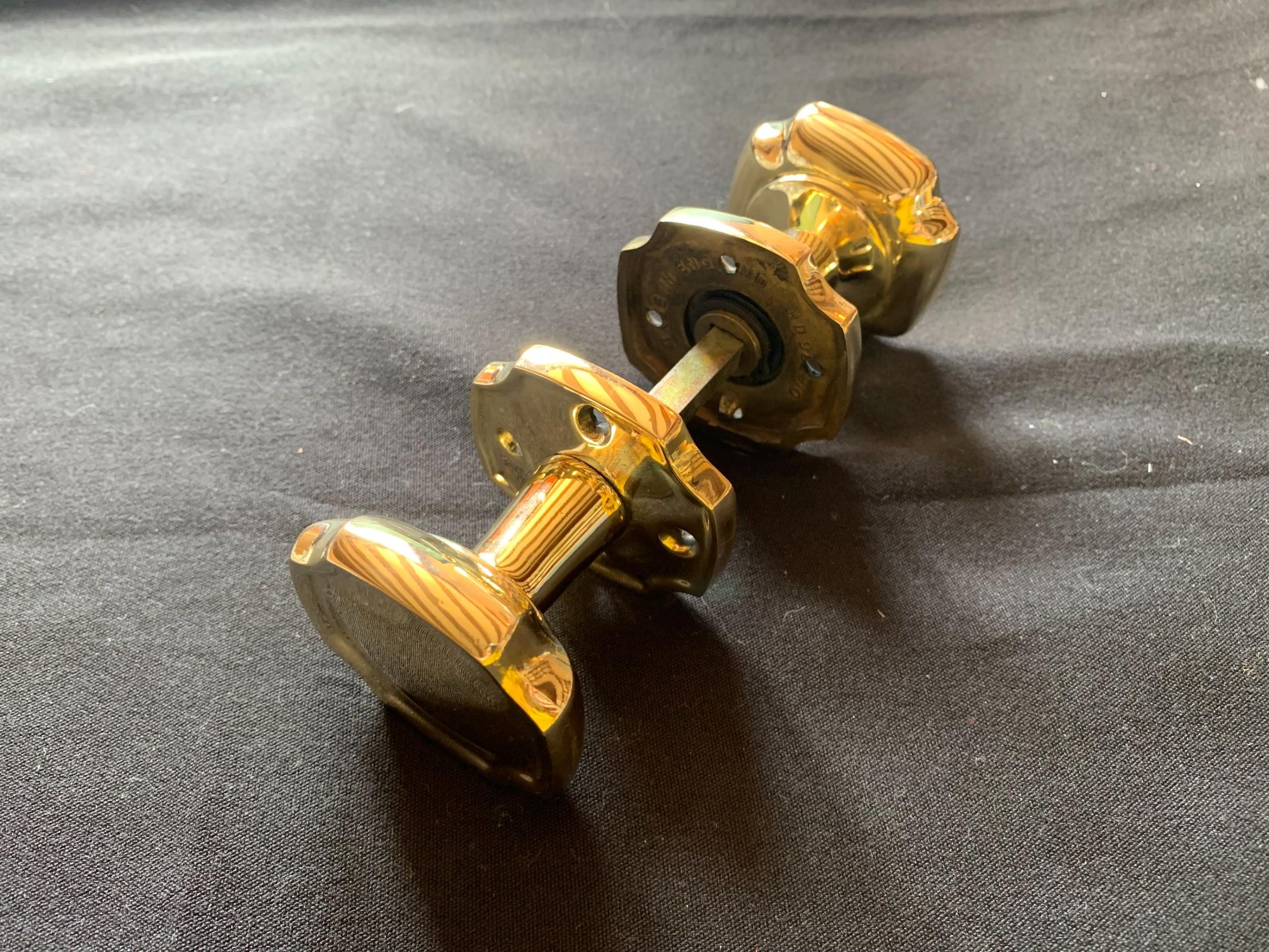 one pair of brass victorian door knobs