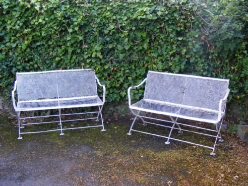 pair of decorative regency style garden benches