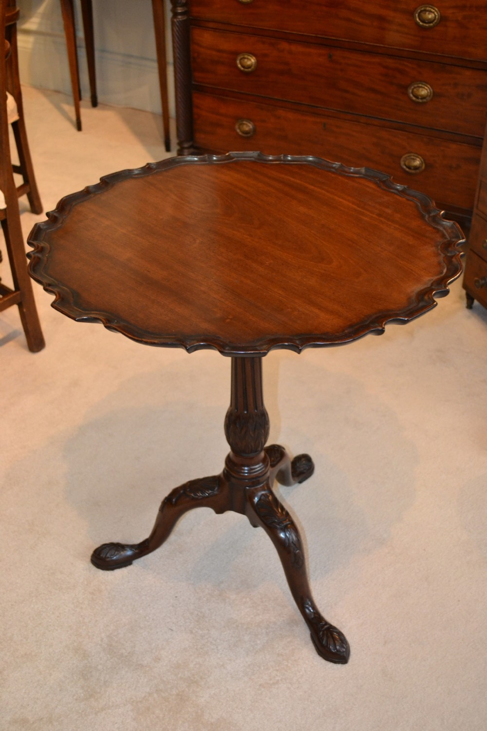 a superb chippendale period finely carved piecrust occasional wine table in excellent condition