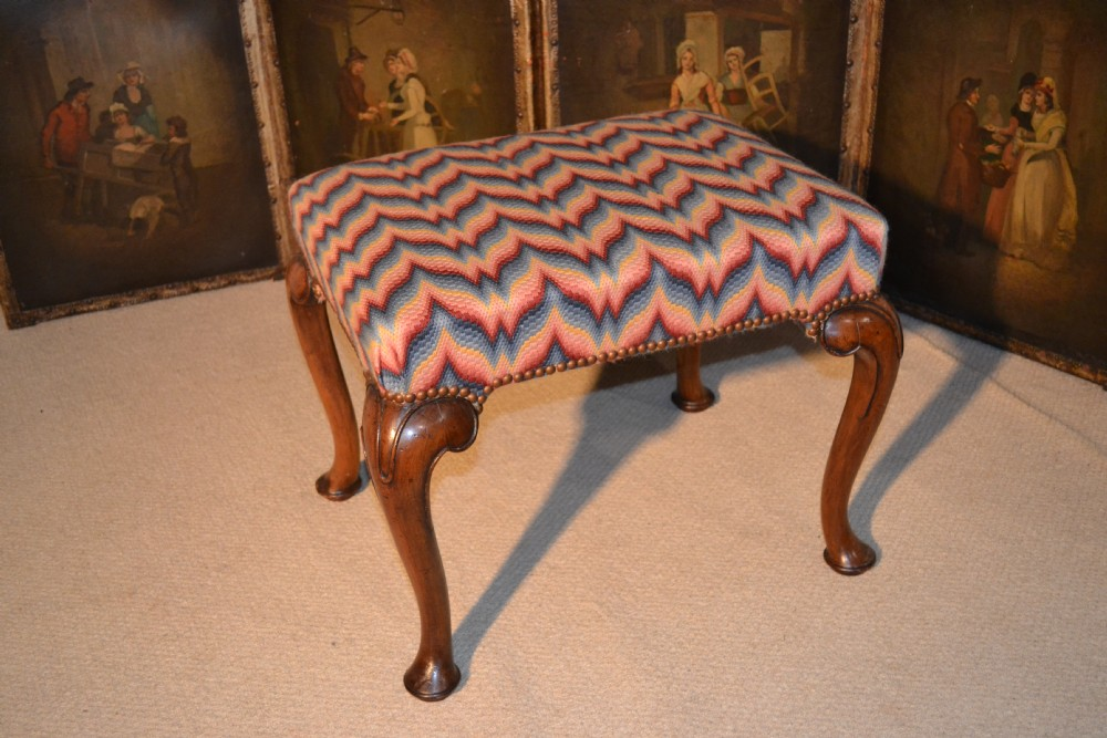 queen anne style walnut stool on carved cabriole legs a unusually decorative needlepoint cover