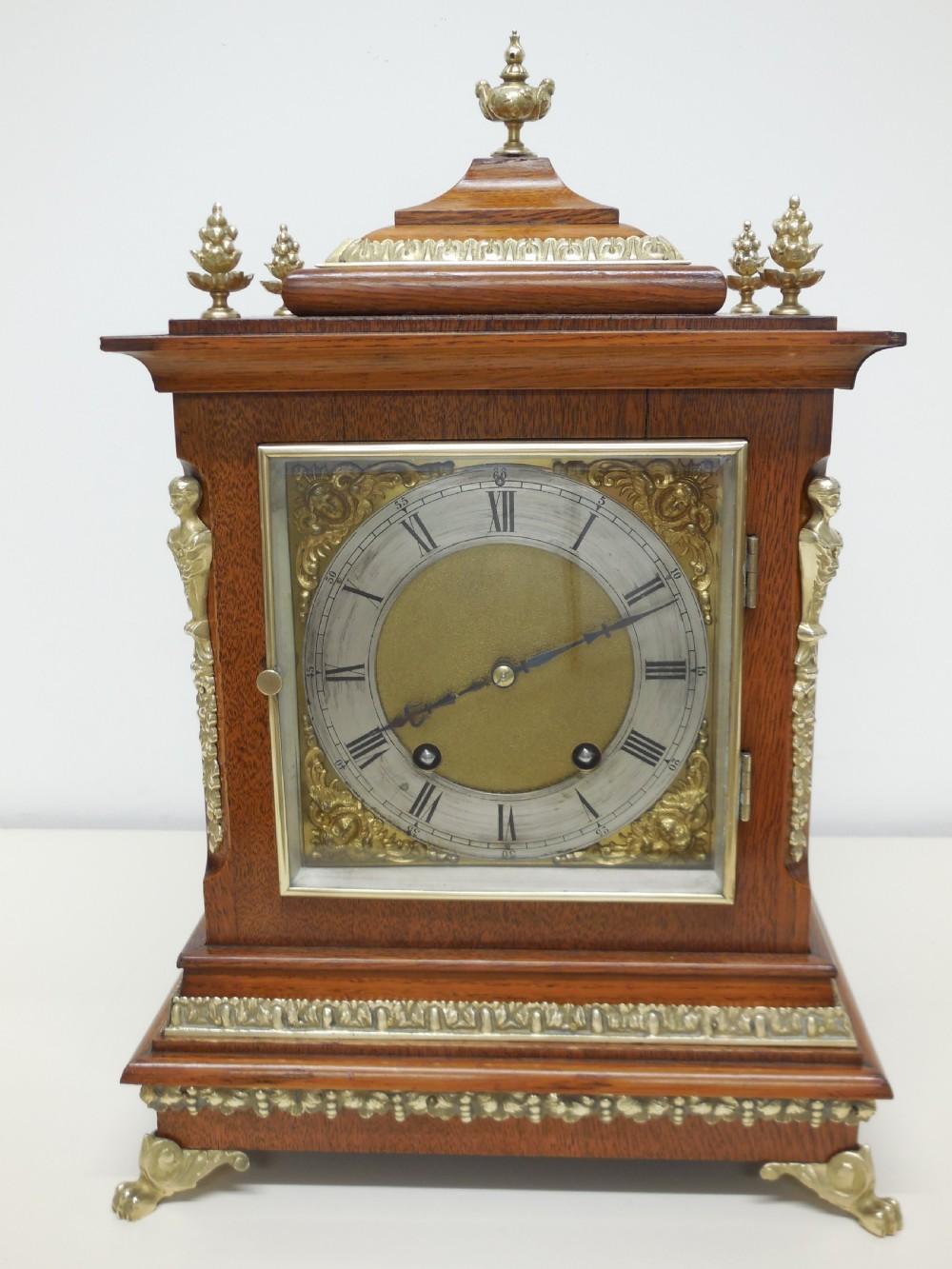 a german oak and brass trimmed mantel clock