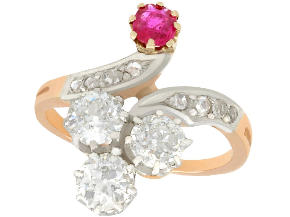 171ct diamond and 030ct ruby 18ct yellow gold twist ring antique french circa 1910
