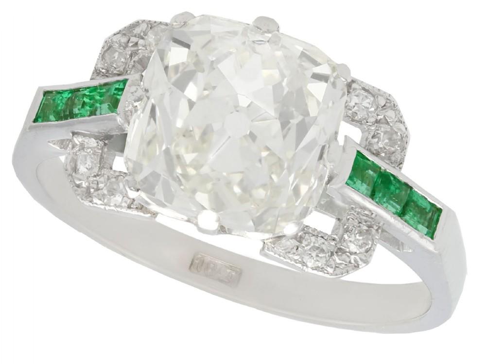 442ct diamond and 022ct emerald 18ct white gold dress ring antique circa 1930