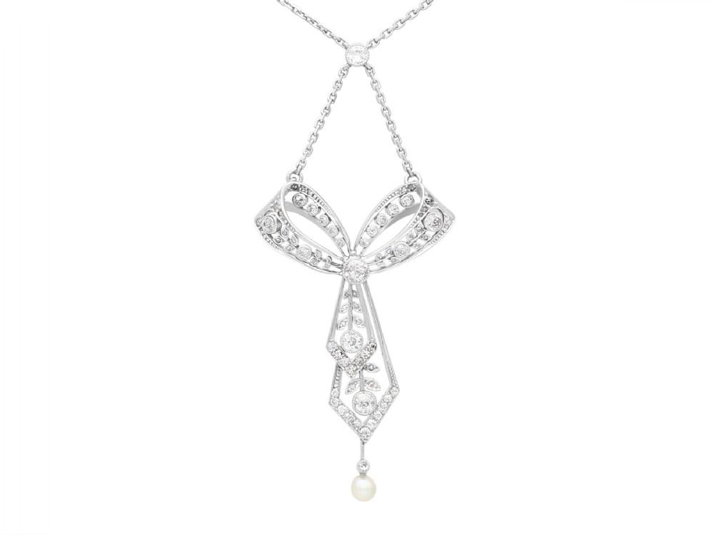 129ct diamond and pearl platinum bow pendant antique circa 1900