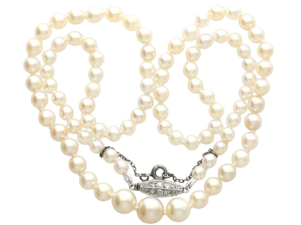 single strand natural pearl necklace with 030ct diamond set clasp antique circa 1930