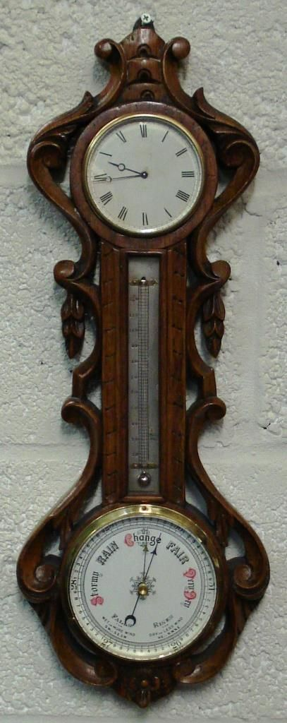 oak cased late 19th century barometer with clock