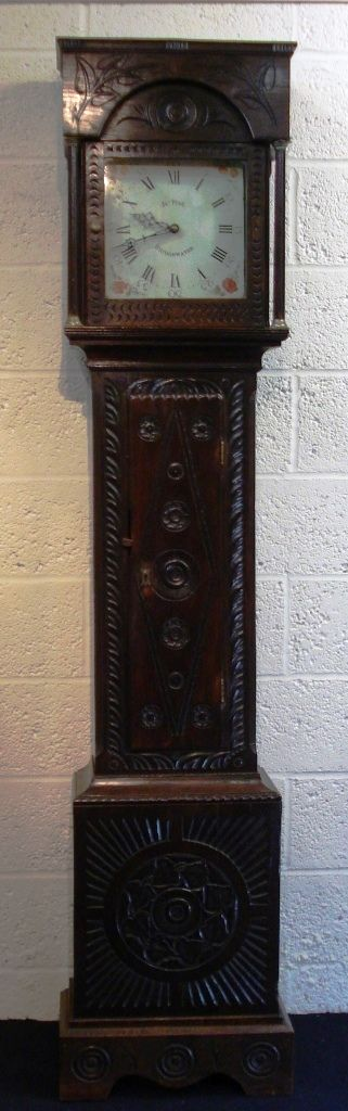 carved oak cased painted face longcase clock