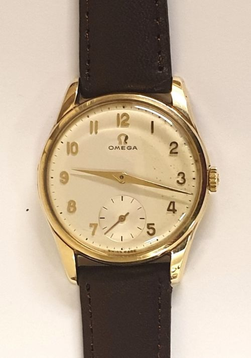 omega 9ct gold cased manual wind wrist watch