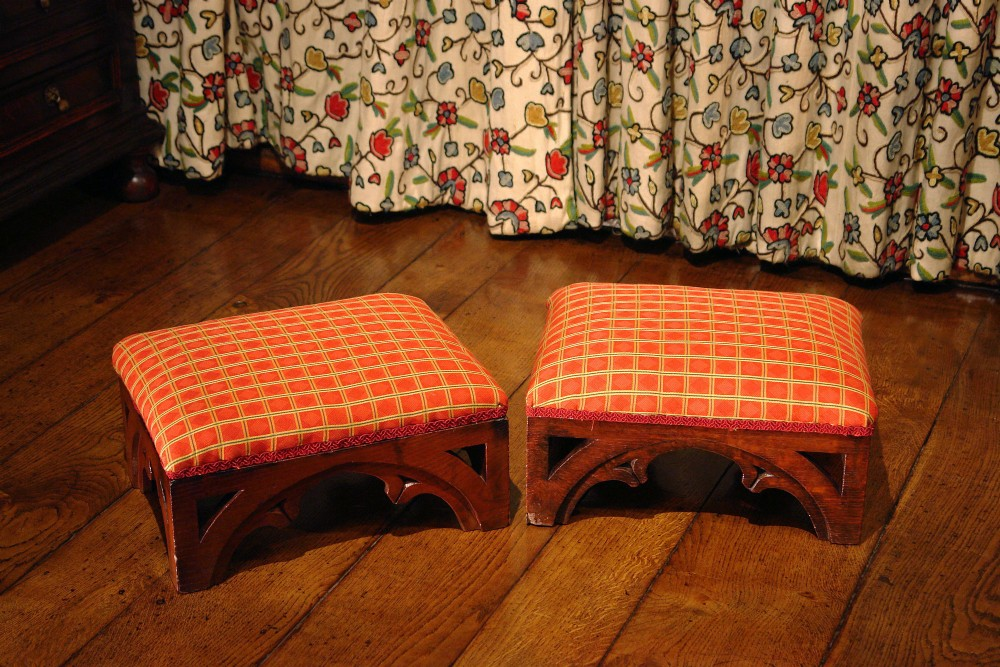 pair of victorian gothic oak foot stools