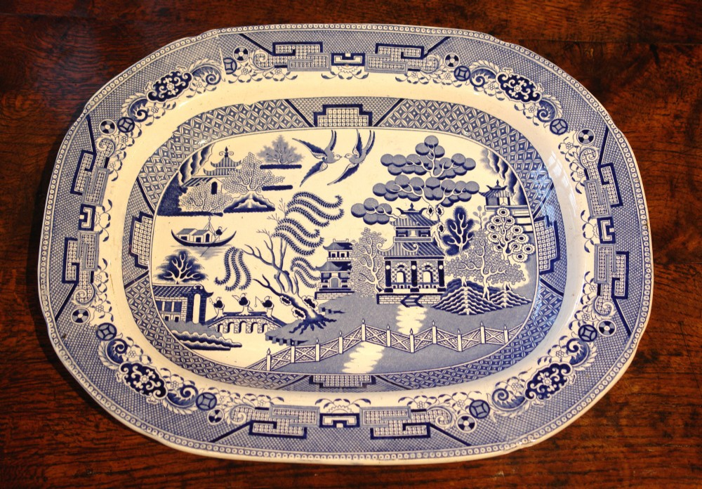 blue and white willow pattern meat plate