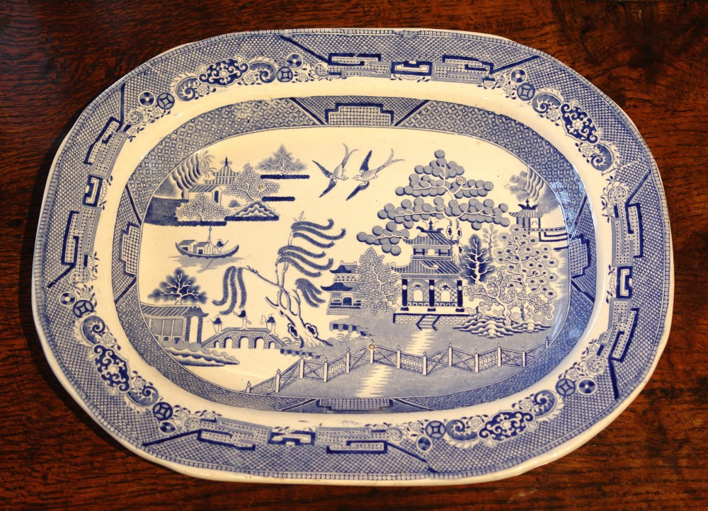 small blue and white willow pattern meat plate