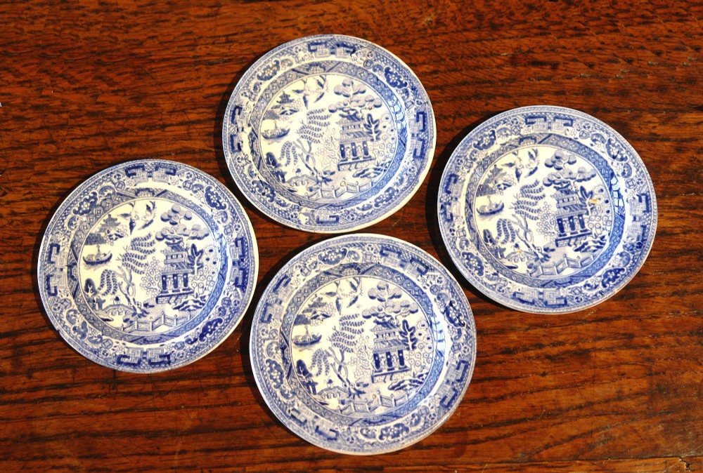 four rare antique miniature blue and white willow pattern plates