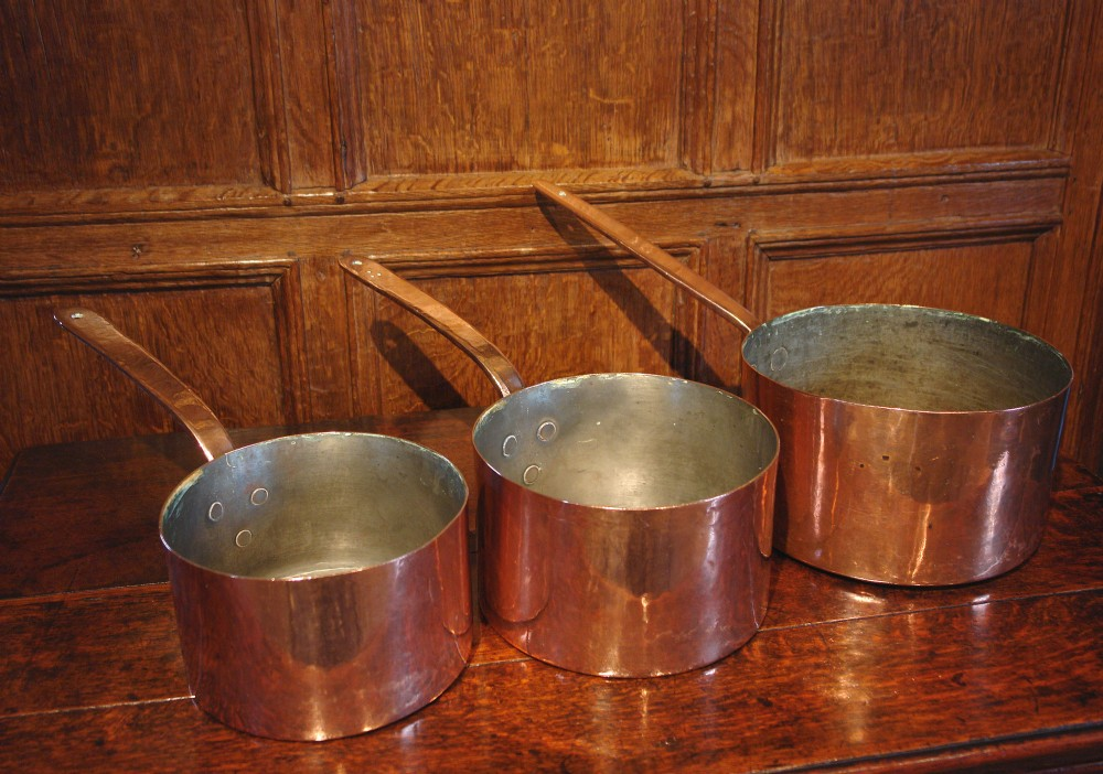 set of three victorian copper pans