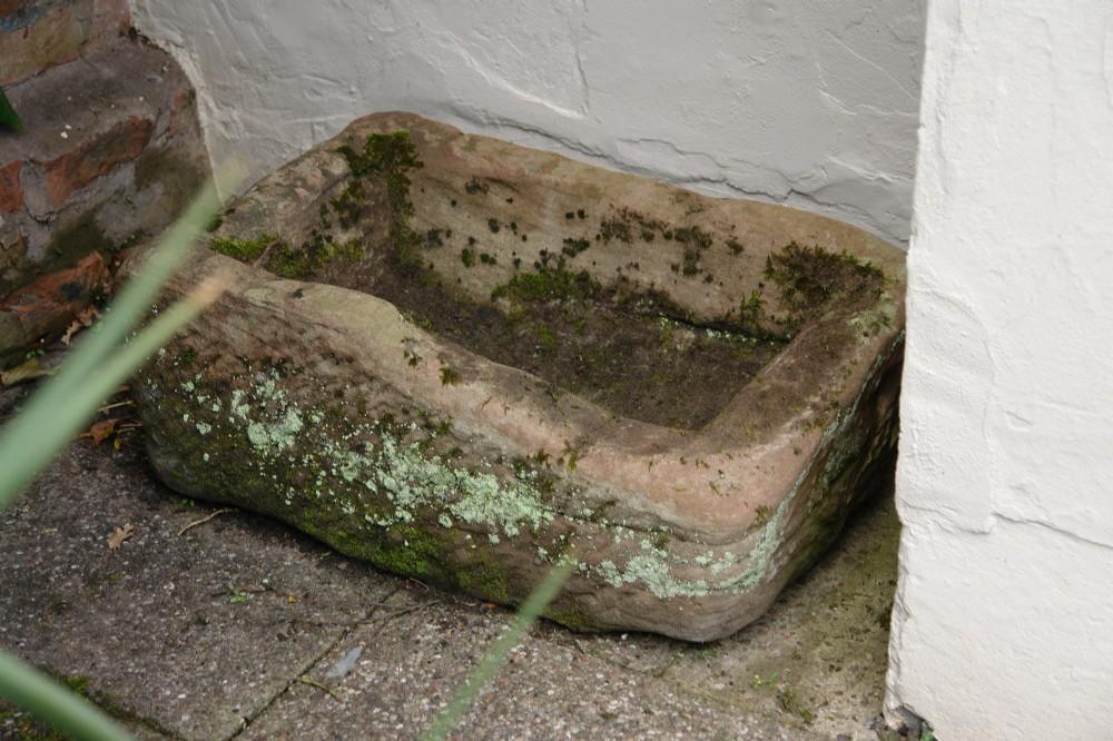antique stone trough planter