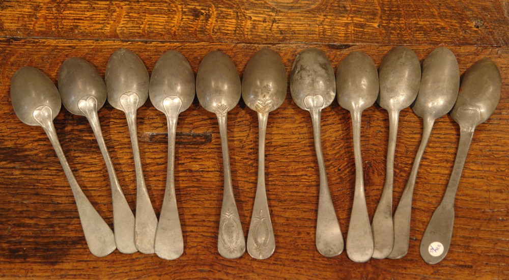 collection of antique pewter spoons