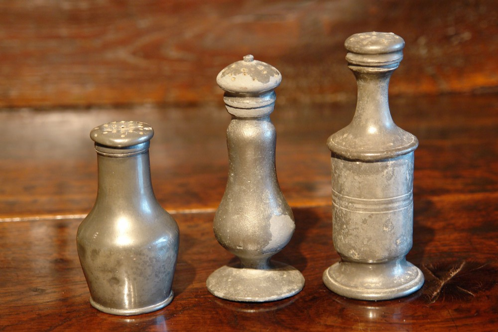 three victorian pewter pepper pots