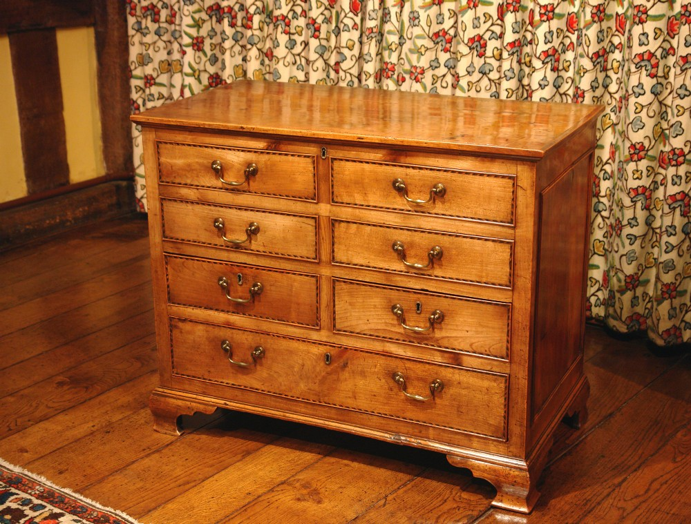 georgian fruitwood chest of drawers with liftup top