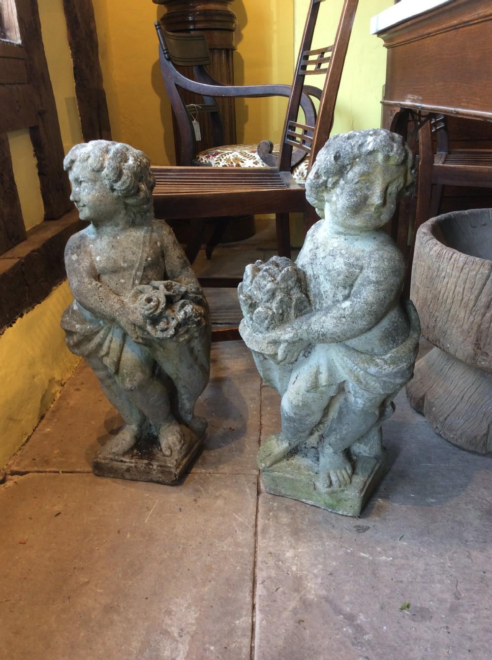 20thc pair of reconstituted stone figures