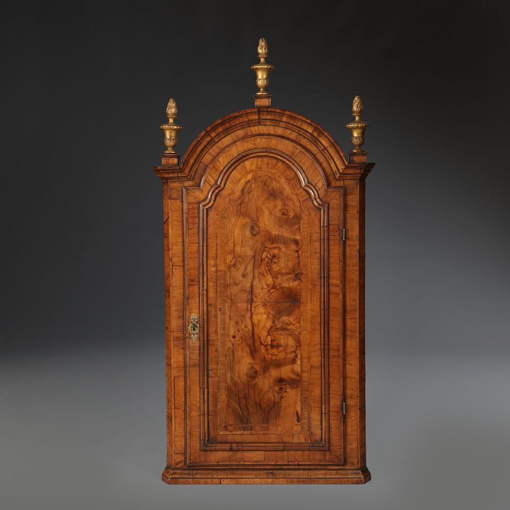 a queen anne walnut dome topped corner cupboard