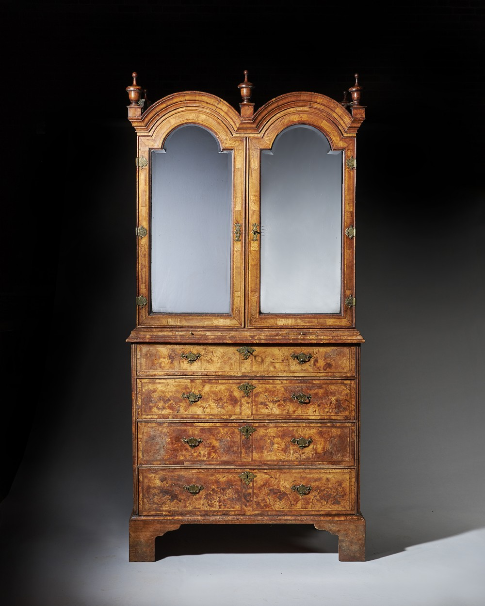 an original highly figured george i walnut double dome bookcase on chest circa 17201730