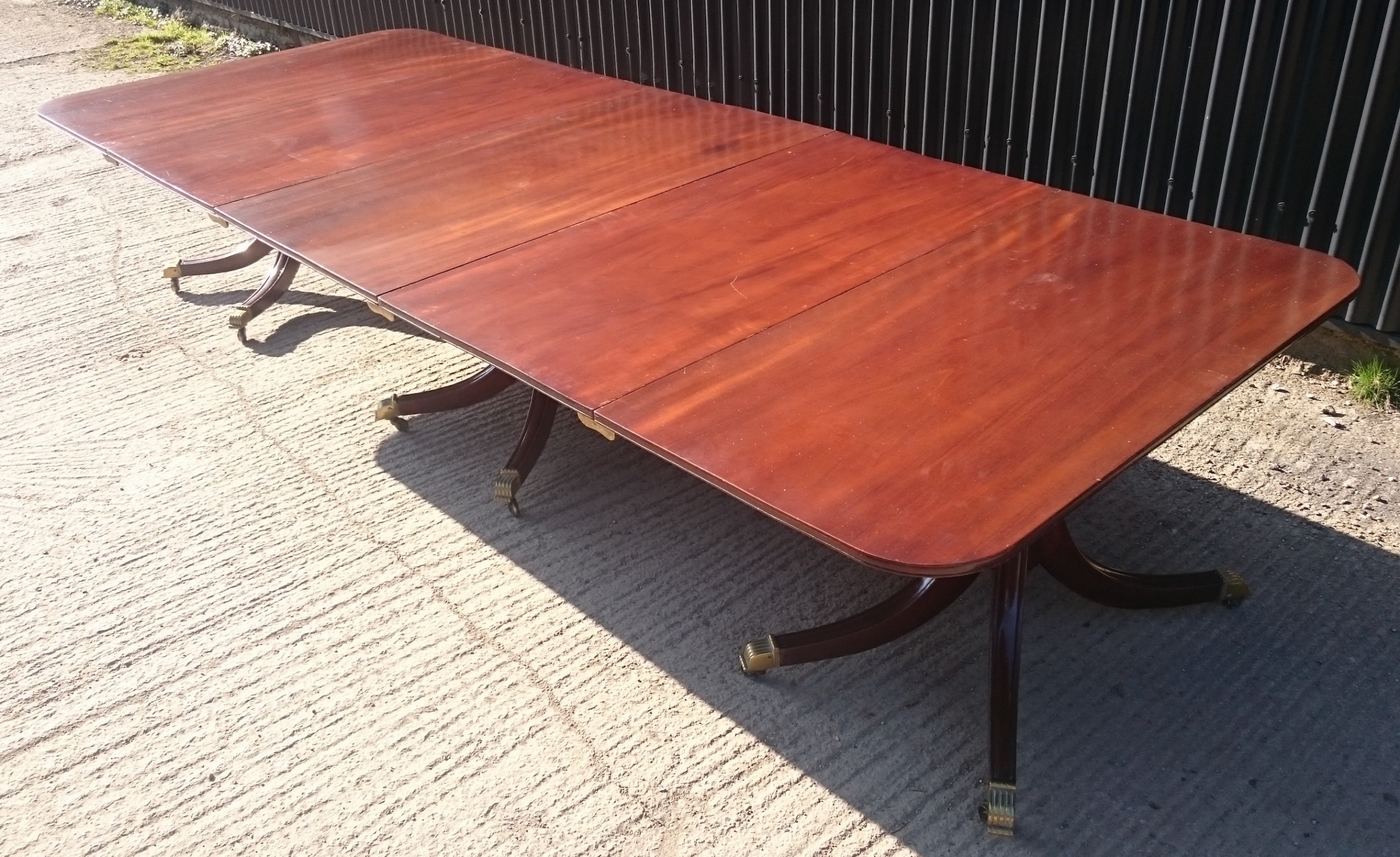 early 19th century mahogany four splay three pedestal antique dining table