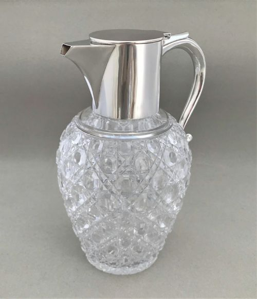 a fabulous victorian silver mounted claret jug