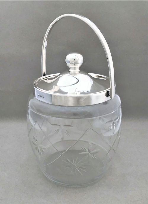 a lovely george v silver mounted biscuit barrel